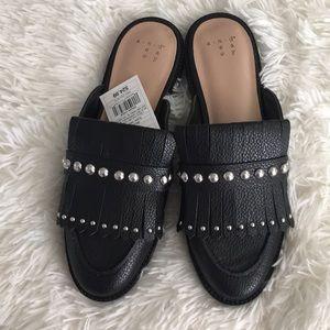 Elegant black leather and silver studs slides